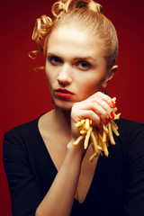 Unhealthy eating. Junk food concept. Woman eating fries