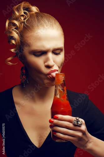 Unhealthy eating. Junk food concept. Girl eating ketchup - 56351575
