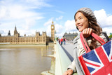 London woman holding shopping bag near Big Ben