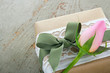 Gift box wrapped in brown paper with rose