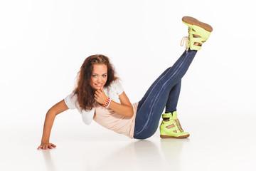 Young beautiful girl dancing modern dance