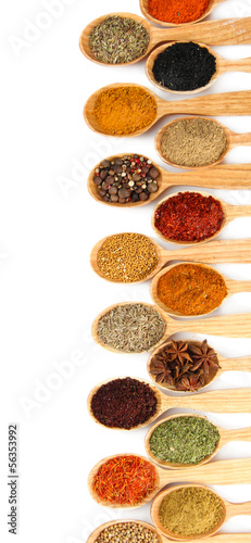 Assortment of spices in wooden spoons, isolated on white - 56353992