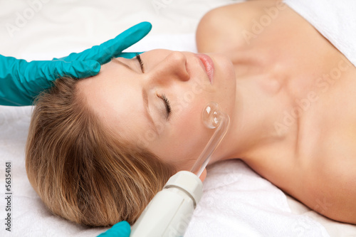 young woman and medical device touching her face