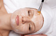 Spa therapy for woman receiving facial mask at beauty salon - 56354381