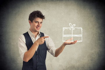 Young man pointing a gift