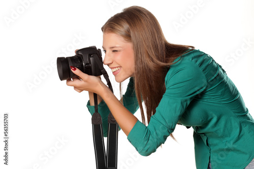beautiful young smiling girl photographing with her camera