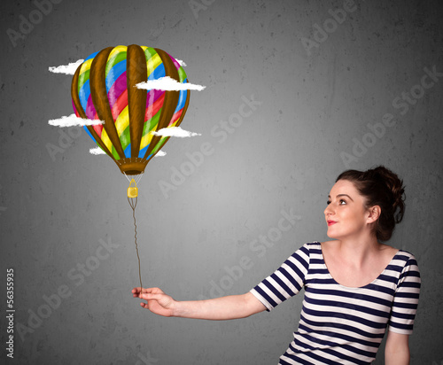 Woman holding a balloon drawing