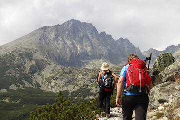 Mountaineers hiking in mountain range of High Tatras in Slovakia