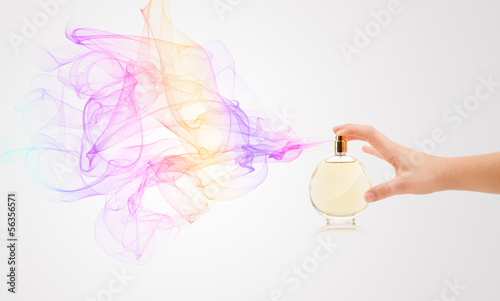 woman hands spraying perfume - 56356571