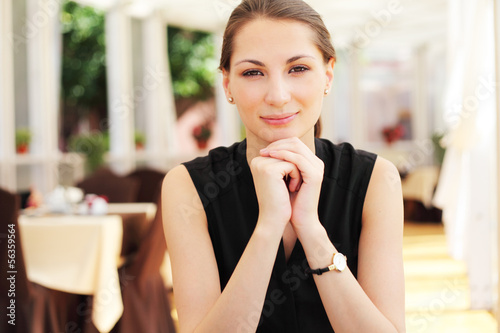 Young beautiful woman portrait in cafe