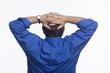 Business man folding hands behind head, horizontal