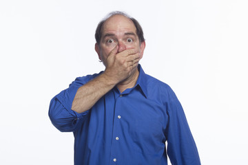Man shocked and covering mouth, horizontal