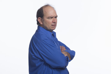 Upset man with arms crossed, horizontal