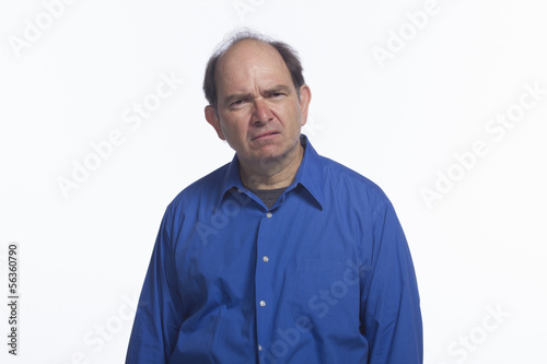Older man looking confused, horizontal