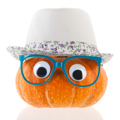 Funny pumpkin with eyes and hat