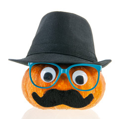 Funny pumpkin with face and hat