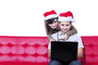 Young hispanic couple christmas shopping online