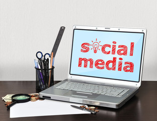 notebook with social media