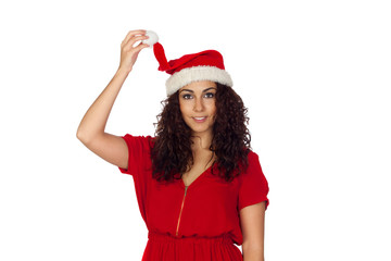 Attractive woman in red holding her Christmas hat