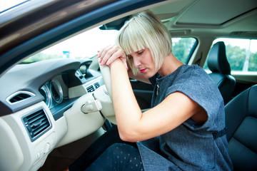 sad woman in her car