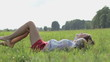 Portrait of young girl enjoying summer on a grass, slow motion
