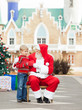 Boy Giving Letter To Santa Claus