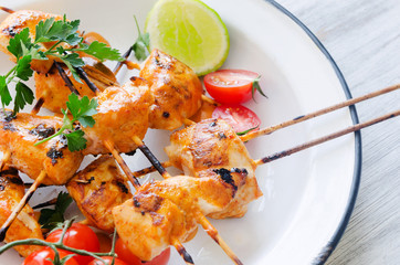 Grilled chicken kebabs with tikka masala sauce
