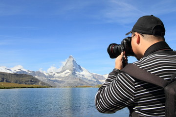 photographer shooting Matterhorn mountain, Switzerland