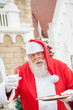 Santa Claus With Cookies And Milk