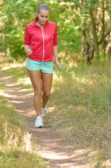 Sports girl run in the forest