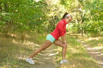 Sports girl in the forest