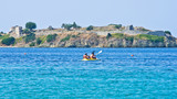 Kayaking on a vacation in front of an old roman fortress ruins