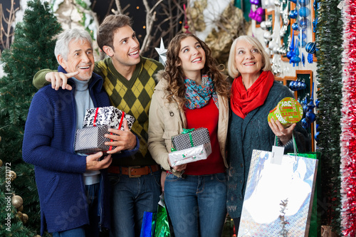 Happy Family Shopping In Christmas Store