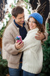 Couple Embracing In Christmas Store