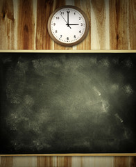 Chalkboard and clock on wall