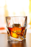 Glass of whiskey, on bright background