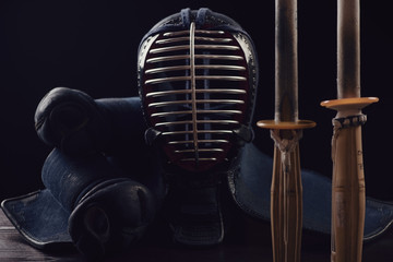 Horizontal shot of kendo equipment, black background