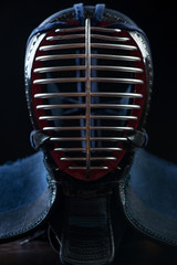 Men - kendo head protection equipment, black background