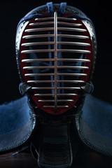 Men - kendo head protection equipment, black background