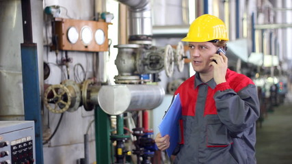 Industrial worker talking on mobile phone