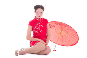 beautiful sitting woman in red japanese dress with umbrella isol