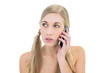 Serious young blonde woman making a phone call