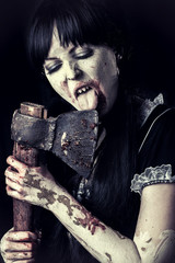female zombie licking bloody axe