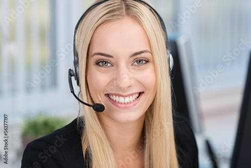 Leinwanddruck Bild freundliche angestellte mit headset