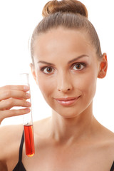 woman holding test tube with red  liquid