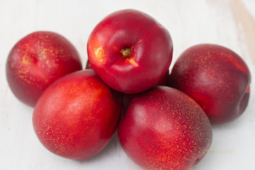 fresh nectarines on table