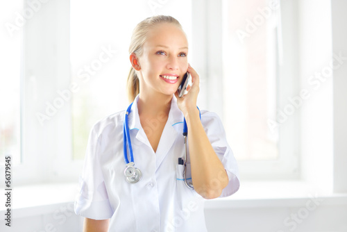 Female doctor talking on the cell phone