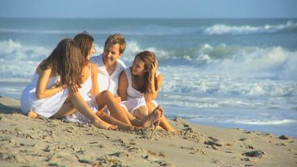Smiling Caucasian Parents Teenage Daughters Beach