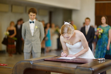 Bride signing a wedding contract