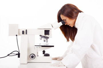Scientist looking through microscope a sample of blood, isolated